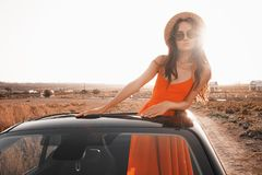 Happy woman in car cabriolet. Outdoor lifestyle photo of beautiful happy woman in car cabriolet. Holiday and travel. Summer trip. Freedom, youth and carefree Stock Photography