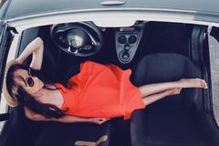 Stylish woman in car cabriolet. Outdoor lifestyle photo of beautiful stylish woman in car cabriolet. Holiday and travel. Summer trip. Freedom, youth and carefree Stock Photo