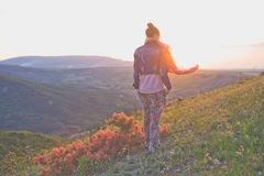 Young woman walking on mountain. Outdoor lifestyle photo of young happy woman walking on mountain. Travel background. Tourism Royalty Free Stock Photography