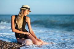 Outdoor lifestyle portrait of beautiful girl in black swimsuit stock photos