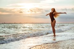 Outdoor lifestyle portrait of beautiful girl in black swimsuit stock images