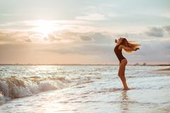 Outdoor lifestyle portrait of beautiful girl in black swimsuit royalty free stock images