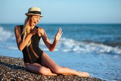 Outdoor lifestyle portrait of beautiful girl in black swimsuit royalty free stock photos