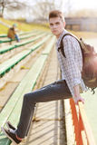 Outdoor lifestyle portrait of handsome guy with backpack. Summer sunny day. Hipster street fashion Stock Images
