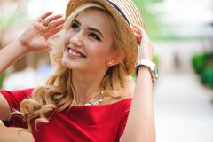 Outdoor lifestyle portrait of stylish girl laughing and smiling. royalty free stock image