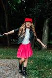 Outdoor lifestyle portrait of stylish little girl teenager on city park. . Beautiful child, wearing. stock photo