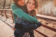 Outdoor lifestyle portrait of young happy couple Stock Photos