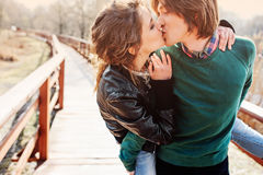 Outdoor lifestyle portrait of young happy couple kissing Stock Images
