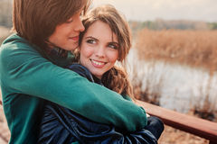 Outdoor lifestyle portrait of young happy couple Stock Photography