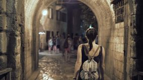 Outdoor Lifestyle Portrait of Young Woman Walking Down The Street At Old Town, Travel With Backpack, Stylish Casual stock video footage