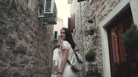 Outdoor Lifestyle Portrait of Young Woman Walking Down The Street At Old Town, Travel With Backpack, Stylish Casual stock video