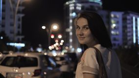 Outdoor Lifestyle Portrait of Young Woman Walking Down The Street, Travel With Backpack, Stylish Casual Outfit, Evening. Outdoor Lifestyle Portrait of Young stock video footage