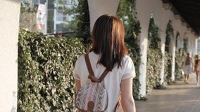Outdoor Lifestyle Portrait of Young Woman Walking Down The Street, Travel With Backpack, Stylish Casual Outfit, Evening. Sunset, 4K stock video footage