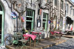 Outdoor little restaurant in Durbuy, Belgium. An outdoor little restaurant in Durbuy, Belgium. Few tables with chairs outside, on the open air. Durbuy is a royalty free stock photography