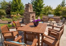 Outdoor living and dining. Enjoying outdoor living this table and outdoor kitchen wait for family and friends to gather and enjoy Royalty Free Stock Photo
