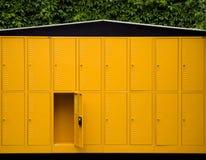 Outdoor Lockers. Yellow empty lockers in garden outdoor Stock Images