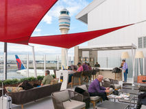 Outdoor lounge and control tower at Atlanta airport, USA Royalty Free Stock Photos