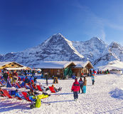 Outdoor lounge on winter sport resort in swiss alps Royalty Free Stock Images