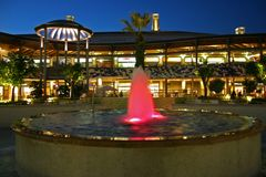 Outdoor mall with a fountain. Partial view of the architecture an outdoor mall with fountain Stock Images