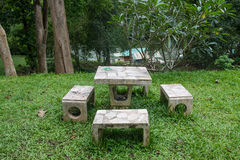 Outdoor marble table and four chairs. Stock Photo