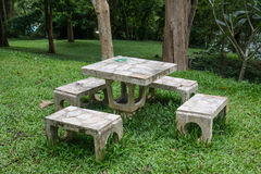 Outdoor marble table and four chairs. Stock Image