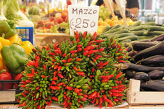 Outdoor market. Outdoor vegetable market - bunches of peppers for sale Stock Image