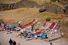 Outdoor market of crafts set up near Inca ruins Stock Image