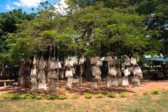 Outdoor Market in Maputo. Pocketbooks on tree for sale at an outdoor market in Maputo, Mozambique Royalty Free Stock Images