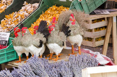 Outdoor market with mushrooms, statues of roosters and lavender. Particular stand in outdoor market with mushrooms, statues of roosters and lavender Stock Photography