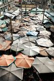 Outdoor market among old building. Amazing panoramic from high view of outdoor market among old building, open air market with group of parasol make impression Stock Images