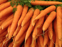 Outdoor market in Paris with fresh carrots Royalty Free Stock Images