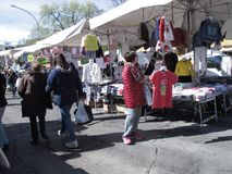 An outdoor market  in the suburbs of Rome. People and stalls for the sale the clothes  in the suburbs of Rome stock photos