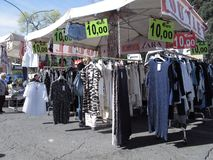 An outdoor market  in the suburbs of Rome. A staller for the sale of the clothes in the suburbs of Rome stock photos