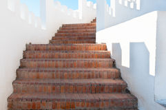 Outdoor Masonry Stairway with White Crenellated Walls at a Luxur Stock Image