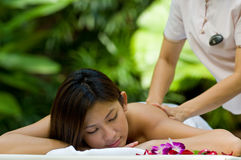 Outdoor Massage. A beautiful young asian having massage outside in natural environment Stock Photo