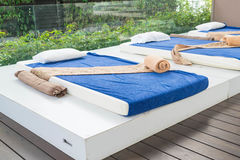 Outdoor massage bed. In a spa salon Stock Photos