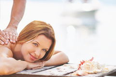 Outdoor massage. Young woman receiving massage on summer resort Stock Images