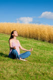 Outdoor meditating Royalty Free Stock Image