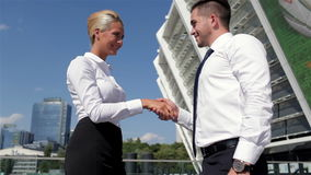 Outdoor meeting of two colleagues. Outdoor meeting of two business colleagues stock footage