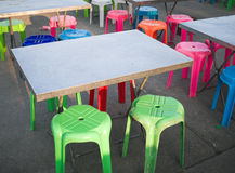 Outdoor metal table and colored plastic chair, street food scene in Thailand Royalty Free Stock Photos