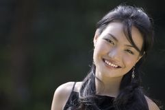 Outdoor Model 13. A pretty young asian model with a great smile poses outside Royalty Free Stock Images