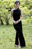 Outdoor Model 3. A beautiful young asian woman in a black evening dress, posing outdoors Royalty Free Stock Photo