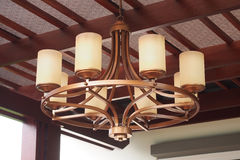 Outdoor modern chandelier hanging on ceiling Stock Images
