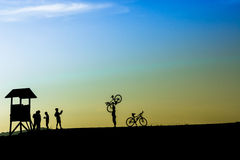 Outdoor mountain bike - cyclists silhouettes on the background. Stock Images