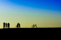 Outdoor mountain bike - cyclists silhouettes on the background. Stock Photography