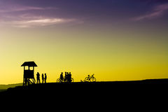 Outdoor mountain bike - cyclists silhouettes on the background. Royalty Free Stock Photo