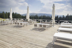 Outdoor mountain restaurant. Outdoor restaurant in the mountains Royalty Free Stock Image