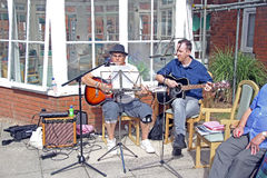 Outdoor musicians playing guitars Royalty Free Stock Photo