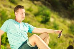 Man spending free time outside, looking at nature stock image