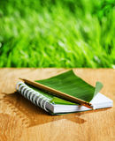 Notepad with cover of leaf  Royalty Free Stock Images